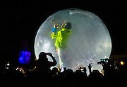 Mark Coyne of The Flaming Lips sings from within a plastic bubble atop the crowd as they perform on the Ambassador Stage during Day 2 of the Life is Beautiful Festival.
