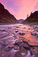 Sunset on Hells Canyon with Snake River.