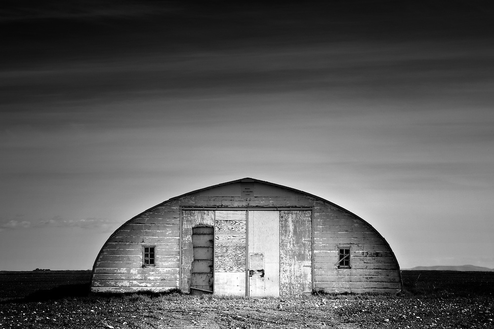 An arched building in an empty pasture just along highway 22 near Claresholm Alberta