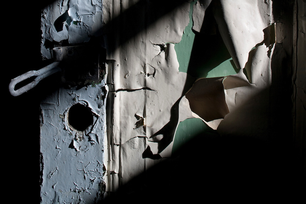 Antarctica, South Georgia Island (UK), Peeling paint inside building among remains of abandoned whaling station at Leith Harbour