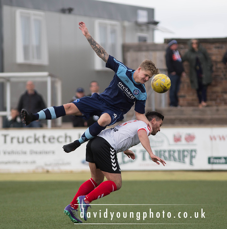Forfar's Michael Travis leaps over the top of Clyde's Sean Higgins during Forfar's 3-0 win over Clyde in SPFL League Two  at Station Park, Forfar, Photo: David Young<br /> <br />  - &copy; David Young - www.davidyoungphoto.co.uk - email: davidyoungphoto@gmail.com
