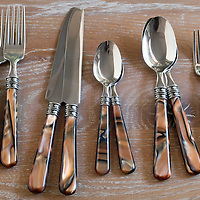 Flatware on wood table surface