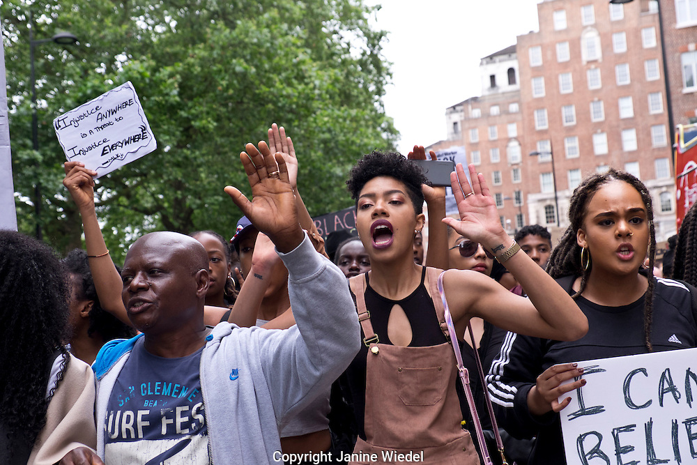 """Black Lives Matter""!  Over a thousand people marched down Oxford Street  and on to Parliament Square outraged by police brutality in the US after the police killing of two black men - one in Minnesota and one in Louisiana. ""Hands up Don't shoot"" photos by Janine Wiedel 10.7.16 London"