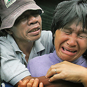 Relatives weep as they attend the funeral of a relative killed during a landslide.