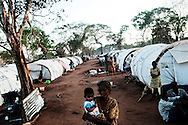 People displaced by the war between the government of Sri Lanka and the LTTE live in a camp for internally displaced people at the Menick farm near Vavuniya, Sri Lanka on July 8, 2009.