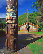 Alaska. Ketchikan. Totem Bight State Historic Park with clan house and totems enshrining native myths and legends.