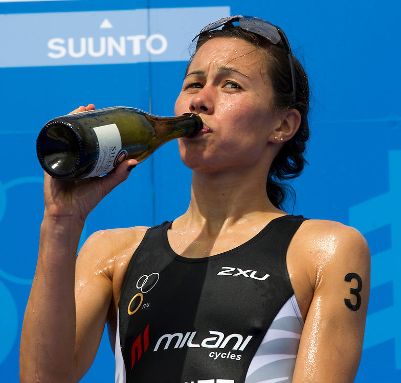 New Zealand's Andrea Hewitt tastes champagne after taking overall 3rd place in the series Elite Women's Race of the World Triathlon Grand Final taking overall 3rd place in the series, Auckland, New Zealand, Saturday, October 20, 2012.  Credit:SNPA / David Rowland