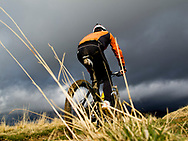 Mountain Bike rider under a stormy sky