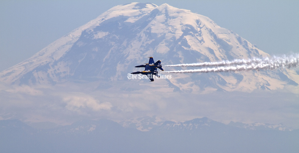 The Navy Blue Angels practice over Lake Washington as Mt. Rainier looms in the distance.<br /> Mike Siegel / The Seattle Times
