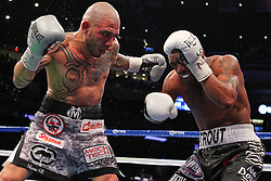 Dec 1, 2012; New York, NY, USA; Austin Trout (black/zebra trunks) and Miguel Cotto (gray camo trunks) trade punches during their 12 round WBA Super Welterweight Championship bout at Madison Square Garden.