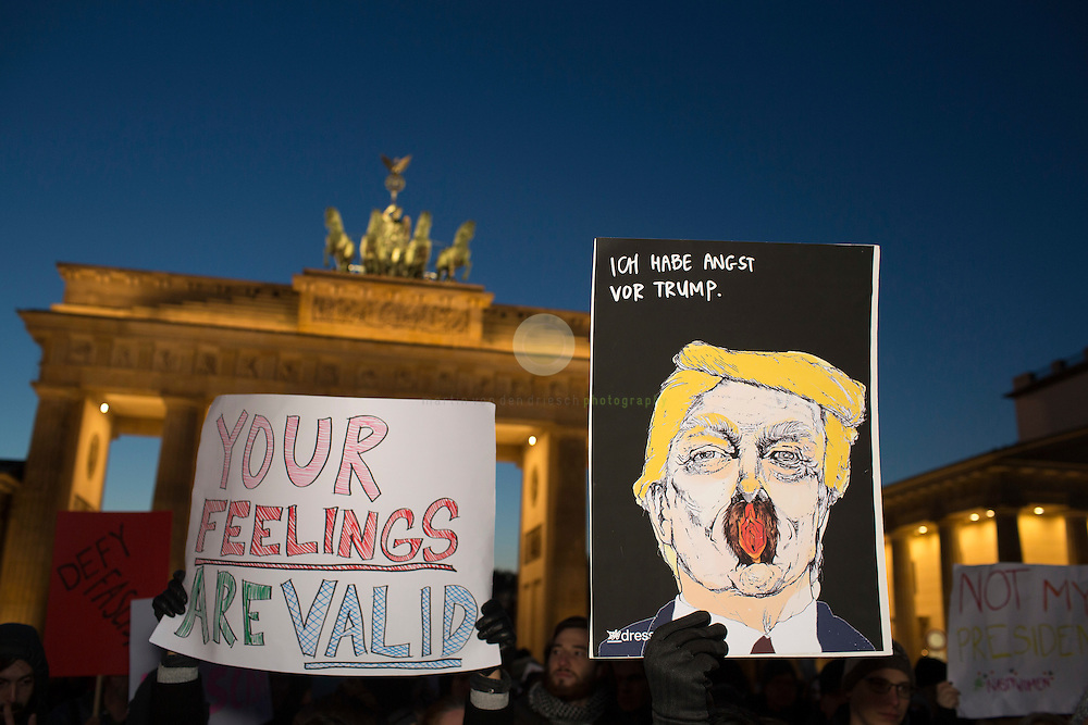 BERLIN, Brandenburg Gate, 12.11.2016 / Hundreds of people, among them many Americans, gathered in the center of the German capital to protest against President-elect Donald Trump.<br /> <br /> About 700 protesters followed a Facebook initiative to rally at the Brandenburg Gate, next to the U.S. Embassy. At this peaceful event, everyone was invited to speak out against Trump and to describe the expectations in the 45th president of the United States. Many spoke about the fear of growing discriminations against minorities.<br /> <br /> The sign on the right reads: I am afraid of Trump