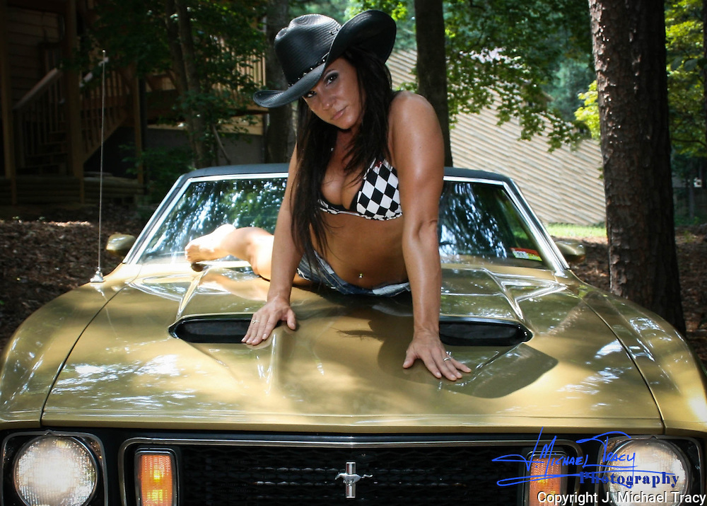Gorgeous cowgirl on hood of a gorgeous 1973 Ford Mustang Mach 1.