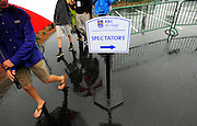 Fans leave the course during a rain delay halfway through the second round of the RBC Heritage golf tournament in Hilton Head Island, S.C., Friday, April 18, 2014. (AP Photo/Stephen B. Morton)