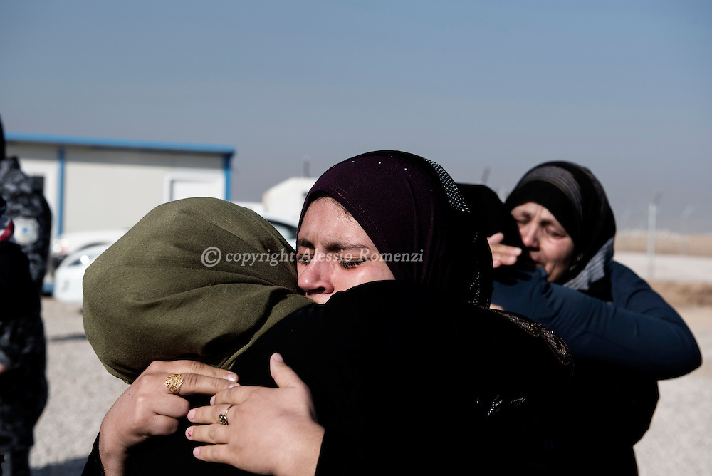 Iraq: IDP's hug each other when they arrived safely at Assan Shame IDP camp after fleeing fighting in Mosul on November 5, 2016. Alessio Romenzi