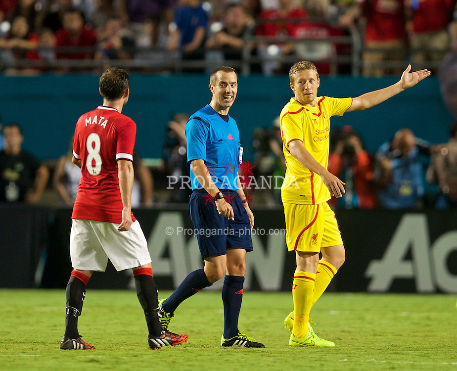 MIAMI, USA - Monday, August 4, 2014: Liverpool's Lucas Leiva jokes with referee Mark Geiger after he almost awarded a goal when the ball went out of play during the International Champions Cup Final match against Manchester United at the SunLife Stadium on day fifteen of the club's USA Tour. (Pic by David Rawcliffe/Propaganda)