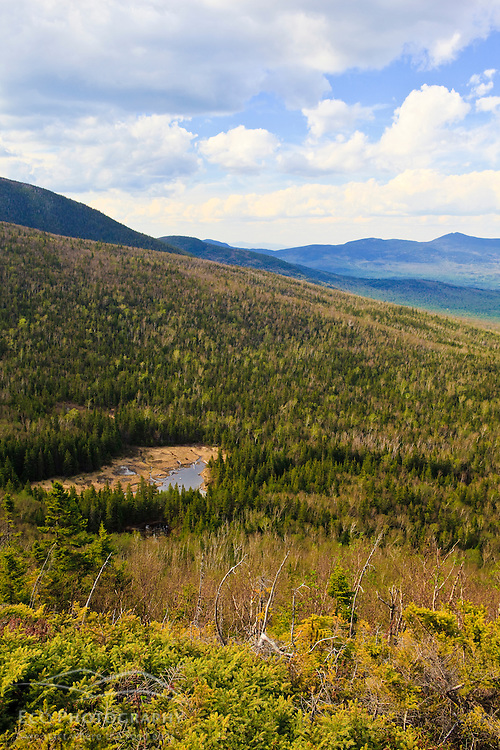 View of Caribou Pond and the distant Bigelow Range from the Appalachian Trail on Crocker Mountain in Stratton, Maine.