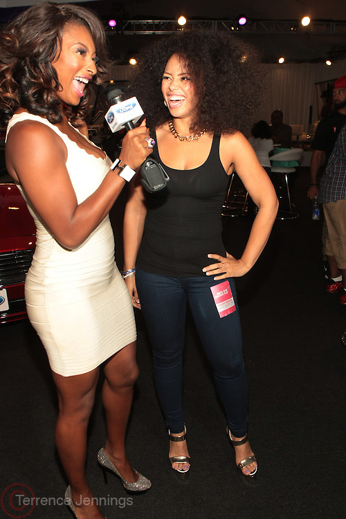Los Angeles, CA-June 29:  (L-R) On-Air personality Toccara Jones and Recording Artist Elle Varner attends the 2013 BET Experience in the FORD loge and held at LA Live on June 29, 2013 in Los Angeles, CA. © Terrence Jennings