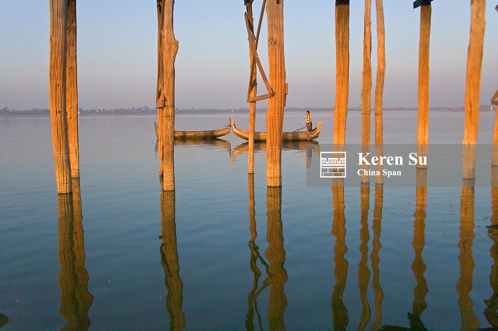 Boat with U Bein teak bridge across Taungthaman Lake, Amarapura, near Mandalay, Myanmar
