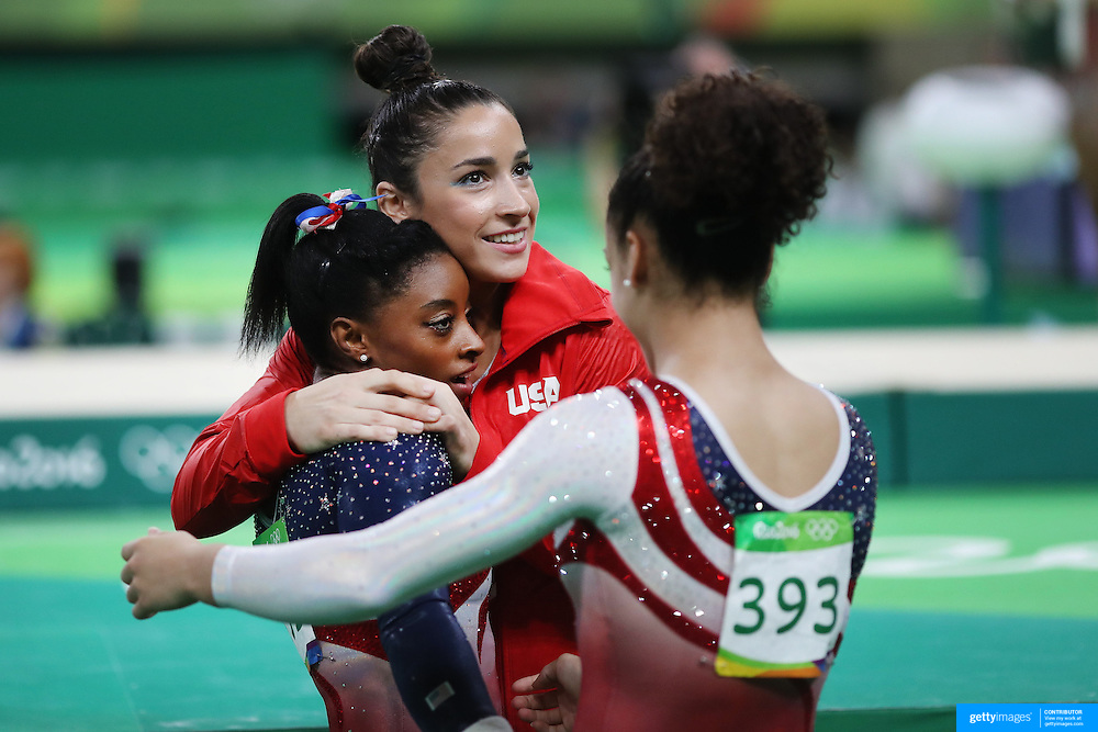 Gymnastics - Olympics: Day 4   Simone Biles of the United States is congratulated by Alexandra Raisman of the United States and Lauren Hernandez of the United States after performing her routine on the Horizontal bar during the Artistic Gymnastics Women's Team Final at the Rio Olympic Arena on August 9, 2016 in Rio de Janeiro, Brazil. (Photo by Tim Clayton/Corbis via Getty Images)