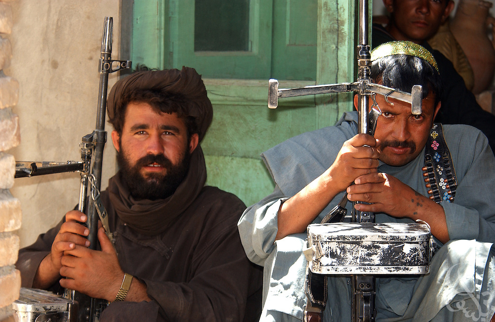 Local Afghan gunmen stand guard in the village of Deh Rawud during a visit by U.S. Army Gen. Dan Mcneill, commander of the Coalition Joint Task Force (CJTF 180) July 7, 2002 in Afghanistan. McNeill used the visit to speak with local leaders about the possibility of stationing more U.S. troops in the region, following an incident last week in which U.S. aircraft mistakenly targeted Afghan civilians celebrating a wedding in the village.