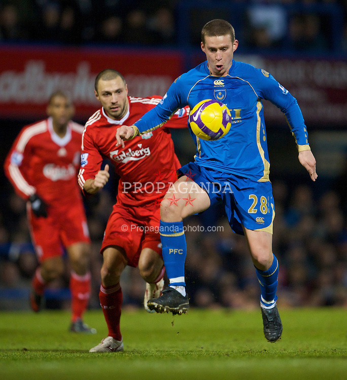 PORTSMOUTH, ENGLAND - Saturday, February 7, 2009: Liverpool's Andrea Dossena and Portsmouth's Sean Davis during the Premiership match at Fratton Park. (Mandatory credit: David Rawcliffe/Propaganda)