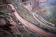 A truck descends the windy Shafer Canyon Road in Canyonlands National Park, Utah.
