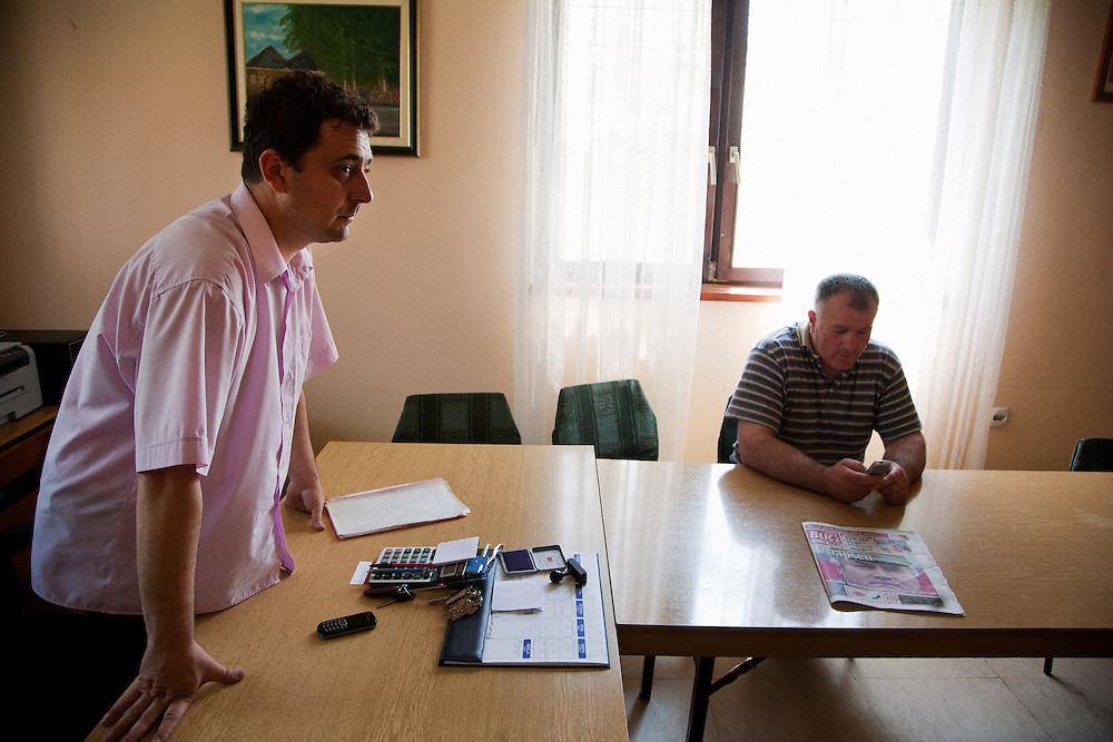 Goran Grahovac, secretary (left), and Radmilo Stanisic, mayor, of Lazarevo, Serbia in their offices...Matt Lutton for The International Herald Tribune..Capture of Ratko Mladic. Lazarevo, Serbia. May 27, 2011.