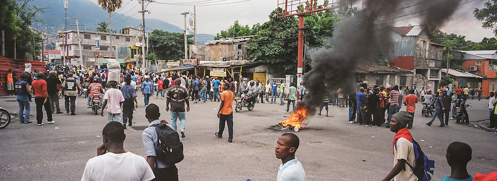 Tires and debris burn in an intersection during an anti-government protest on Tuesday, December 16, 2014 in Port-au-Prince, Haiti. President Michel Martelly was elected in 2010 with great hope for reforms, but in the wake of slow recovery and parliamentary elections that are three years overdue, his popularity has suffered tremendously, forcing Prime Minister Laurent Lamothe to resign.