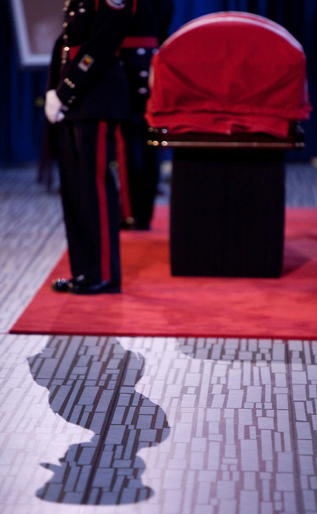 Toronto, Ontario ---11-08-27--- A Toronto police honour guard stands with the casket of the late NDP leader Jack Layton as he lays-in-repose at City Hall in Toronto, Ontario, August, 27, 2011. The leader of the opposition will be memorialized in a state funeral later in the day.<br /> AFP/GEOFF ROBINS/STR