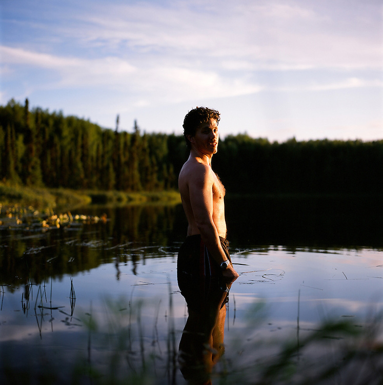 Man in a lake in Alaska. 2010