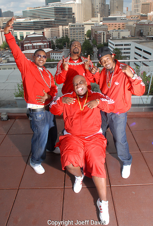ATLANTA, GA - 2009:  Goodie Mob shot on the roof of the Glenn Hotel in downtown Atlanta. <br /> <br /> Goodie Mob is Cee Lo (bald), T-Mo (glasses), Khujo (braided Hair), Big Gipp (cap)