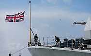 Sailors raise the Union Jack on the bow of the Type 23 frigate HMS Richmond returns to Portsmouth Royal Navy Base following a seven-month deployment to the South Atlantic. Picture date: Friday 21st February, 2014. Photo credit should read: Christopher Ison. Contact chrisison@mac.com 07544044177