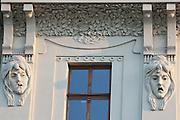 Art nouveau Sculptural heads on facade of building on Nadrazni (railway station) street in Ostrava, Czech Republic