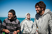 Piri Wepu, Corey Flynn and Sam Whitelock share a laugh as Carlo Muollo makes a joke about the aphrodisiac properties of raw crayfish. All Blacks team members go Line Fishing in the Cook Strait with Tony and Carlo Muollo on board the Marco Polo and then go to Fish Fins in Newtown to eat freshly caught groper...Photo by Mark Tantrum | www.marktantrum.com
