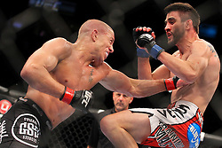 Montreal, Quebec, CAN - November 17, 2012: UFC Welterweight Champion Georges St. Pierre (black Trunks) and Interim UFC Welterweight Champion Carlos Condit (red trunks) during their main event bout at UFC 154 at the Bell Centre in Montreal, Quebec, Canada. St. Pierre won via unanimous decision.