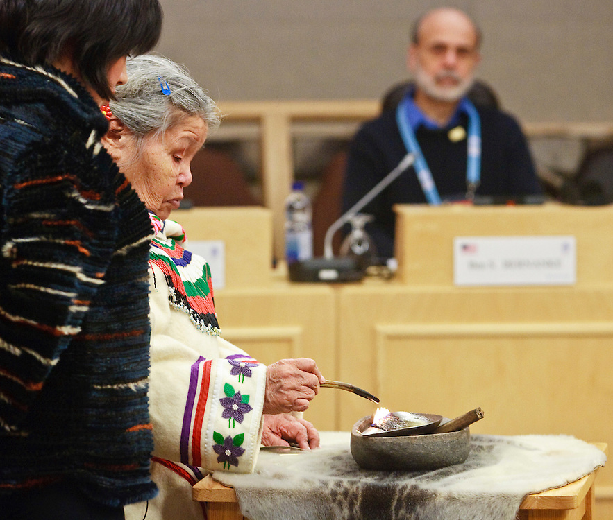 US Federal Reserve Chairman Ben Bernanke, right, watches as an Inuit elder performs a ceremony at the start of talks at the G7 Finance Ministers Meeting, February 6, 2010, in Iqaluit, Canada.<br /> AFP/GEOFF ROBINS/STR