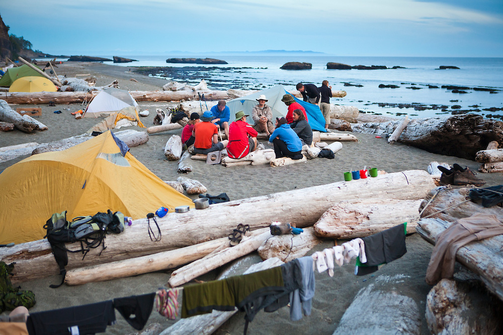 Hikers socialize at camp on Tsusiat Beach, West Coast Trail, British Columbia, Canada.