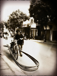 Man transports a load of iron rods with his bicycle, Hanoi, Vietnam, Southeast Asia