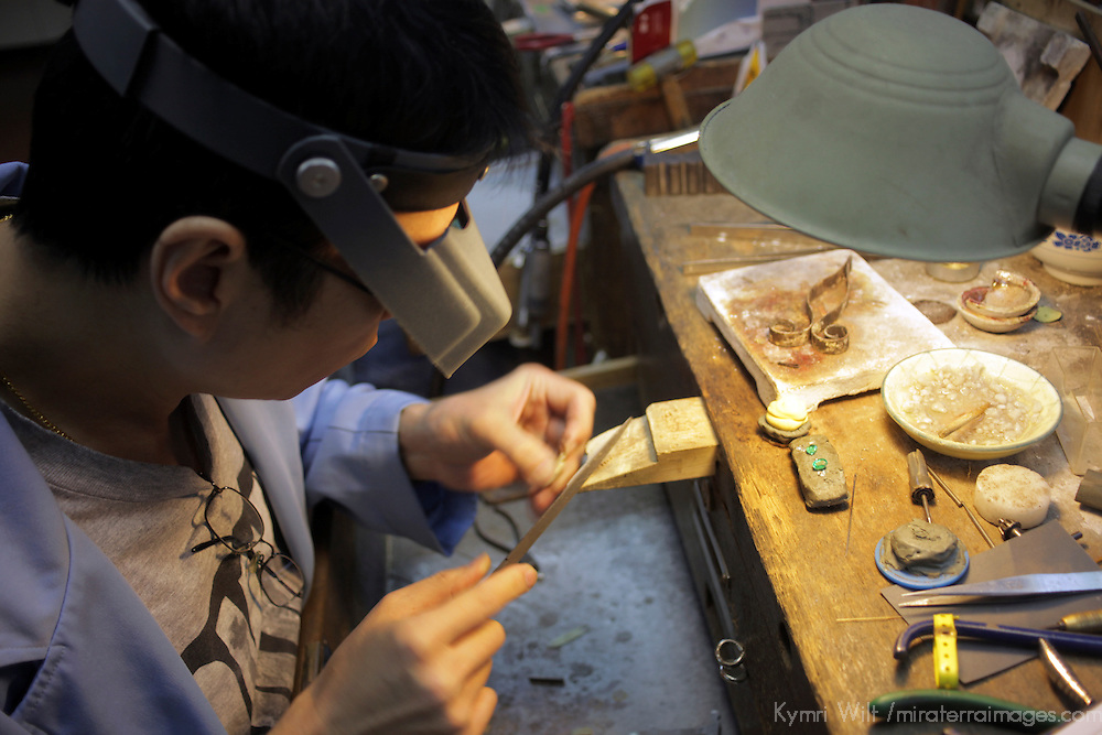 Asia, China, Hong Kong. Jeweler at workshop of Aberdeen Jewellers.