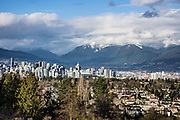 From Queen Elizabeth Park atop the City of Vancouver's highest point, view an urban panorama crowned by the mountains of its North Shore, in British Columbia, Canada. A former rock quarry on Little Mountain (501 feet) has been converted into the beautiful Queen Elizabeth Park with flower gardens, public art, grassy knolls, and Bloedel Conservatory (address: 4600 Cambie Street).