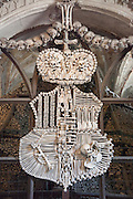Kostnice (Ossuary) with sculpture made from human skulls and bones, Kutna Hora, Czech Republic