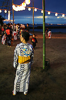 "Yukata is a Japanese summer robe. People wearing yukata are a common sight at fireworks displays, bon odori festivals and other summer events. The yukata is a casual form of kimono that is also frequently worn after bathing at traditional Japanese inns. Though their use is not limited to after bath wear, yukata literally means ""bath clothes"". Like other forms of clothing based on traditional Japanese garments, it is made with straight seams and wide sleeves. Unlike formal kimono, yukata are typically made of cotton rather than silk. Traditionally yukata were mostly made of indigo-dyed cotton but today a wide variety of colors and designs are available. Like the more formal kimono, the general rule is the younger the person, the brighter the color and bolder the pattern."