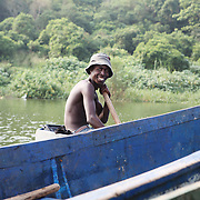A fisherman slowly rows by to socialize with some friends on Lake Victoria. Here in Ggaba, a small town in southern Uganda that almost entirely subsists on the fishing industry, the locals have contributed to the dangerous overfishing of the lake despite strict regulations from Tanzania, Uganda, and Kenya. Fishermen continue to keep fish that are far below the required minimum weight and employ dymanite and poison.
