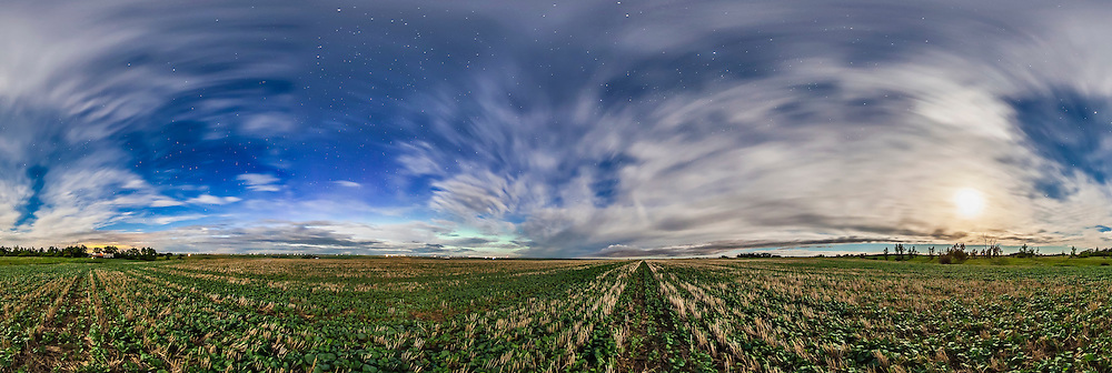 The field next to my house and sky at summer solstice, June 20, 2013 with a waxing gibbous Moon. This is a 360° panorama, from 8 frames at 45° spacing with the Sigma 8mm fish-eye lens, each 30 seconds at f/3.5 and ISO 1000. A dim aurora is to the north at left.