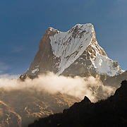 Machhapuchhre (or Machhapuchhare), the Fish Tail Mountain (22,943 feet / 6997 meters elevation) a sacred peak, illegal to climb. This view is from the trail upstream from Bamboo, in the Annapurna Range of Nepal.