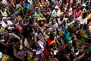 Hundreds of displaced families from LRA violence wait for supplies and bedding to be distributed by the UN.