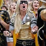 SHOT 9/1/13 6:08:41 PM - Colorado football fan Courtney Benejam, 23, a senior business management major cheers on her team against Colorado State during the 2013 Rocky Mountain Showdown at Sports Authority Field at MiIe HIgh Stadium in Denver, Co. Colorado won the annual in-state rivalry 41-27. (Photo by Marc Piscotty / © 2013)
