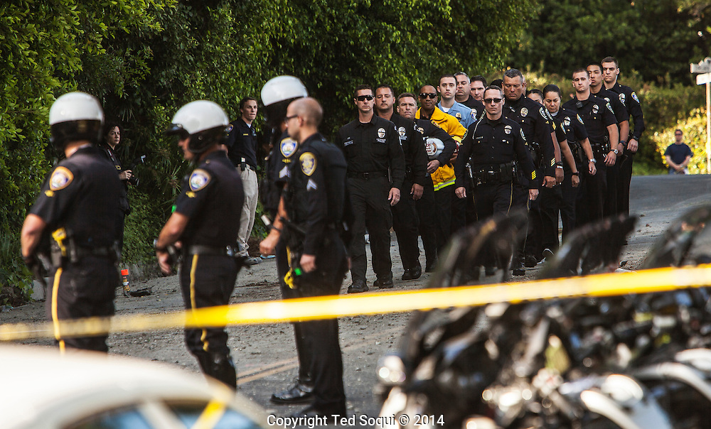 An off-duty Los Angeles police officer was killed when a cement mixer struck his pickup truck along the same hilly road in Beverly Hills where an LAPD officer was killed in March in a<br /> collision with a dump truck.