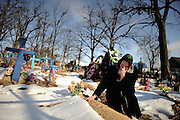 On April 26 - 2011.25 years after the Chernobyl disaster people are still suffering from the long term consequences of a nuclear meltdown. Countries affected struggle with cronic illness, contaminated food - For many their life ended with Chernobyl...<br /> A woman crying at her husbands grave in the village of Drosdyn only a few kilometers from the border to Belarus. The village is known to one of the most poluted in the entire region. Drosdyn, nuclear polluted village, Ukraine.
