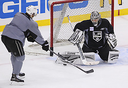 May 29; Newark, NJ, USA; Los Angeles Kings goalie Jonathan Quick (32) makes a save on Los Angeles Kings right wing Dustin Brown (23) during Stanley Cup Finals media practice day at the Prudential Center.